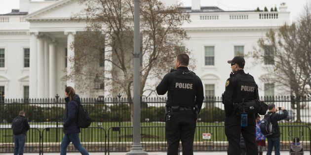 Members of the Secret Service Uniformed Divison patrol alongside the security fence around the perimeter...