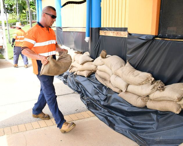 Local Townsville residents and council workers were sandbagging homes and businesses in Townsville on...