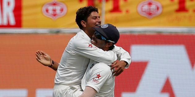 That's the 'Chinaman' Kuldeep Yadav (left) celebrating getting out Glenn