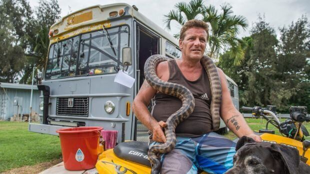 Shane Borgas says his can't leave his two pythons, Great Dane and the 1981 school bus he calls