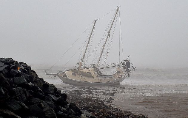 A ship thrown onto the rocks near the marina during Cyclone Debbie in Airlie
