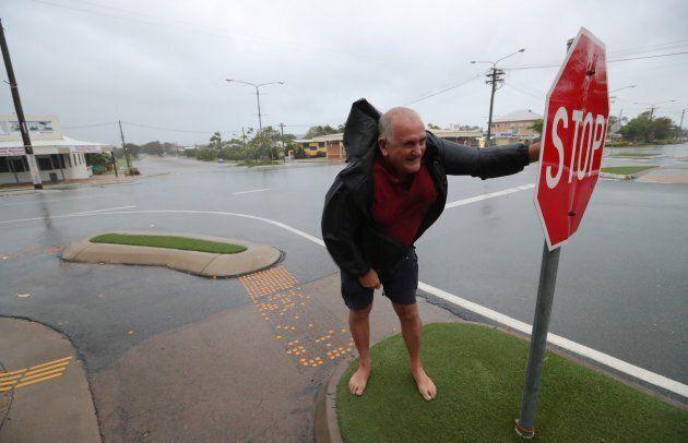 Local Bob Morton battling the wind in