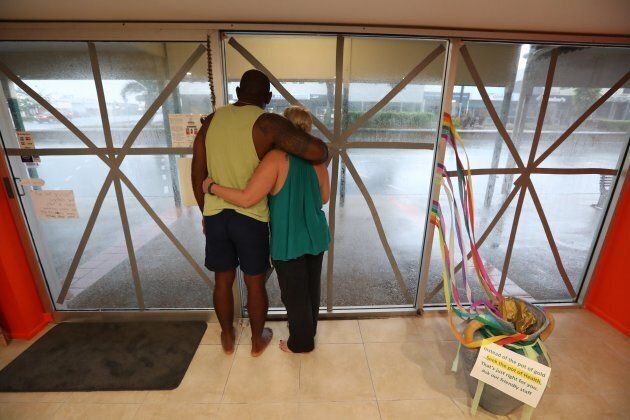 Local business owners Roger Matakamikamica and Tyler Matakamikamica watch Cyclone Debbie's approach in
