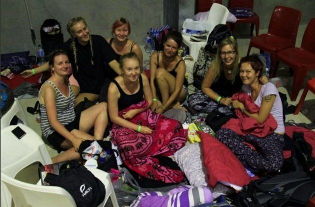 Backpackers shelter at an evacuation centre in Ayr as Debbie builds offshore on