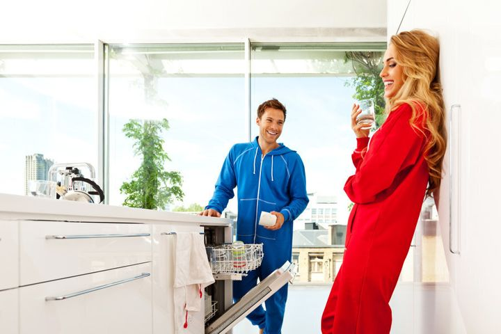 These snuggie-wearing people have clearly got dish washing down pat.