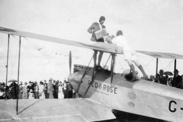 Miller (back to camera) and Lancaster refuelling the over-wing tank at Toowoomba on their way south after...