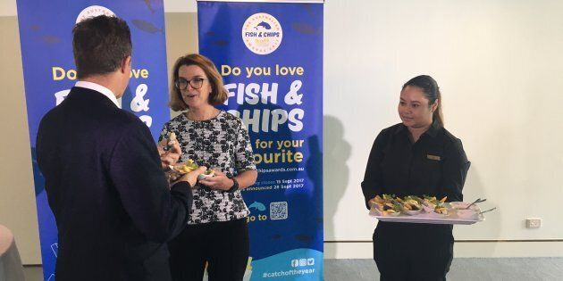 Anne Ruston tries out some fish and
