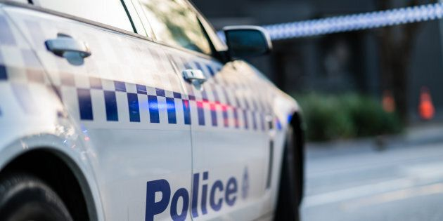 A man has allegedly assaulted paramedics assisting his pregnant partner.