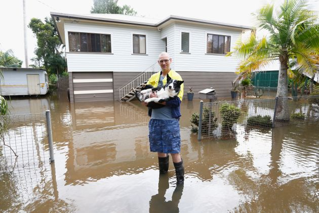 Lismore resident Michael with his dog ' Buddy' outside their house on April 1,
