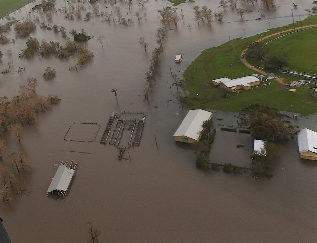 Damaged and flooded areas can be seen from an Australian Army helicopter after Cyclone Debbie passed...