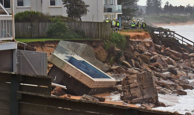 An inground pool sits amongst the rocks after a severe storm at Collaroy on Sydney's northern beaches...