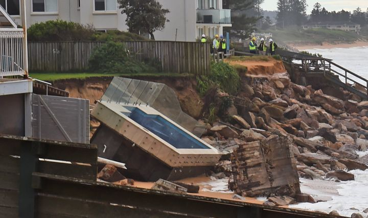 An inground pool sits amongst the rocks after a severe storm at Collaroy on Sydney's northern beaches on June 6, 2016.