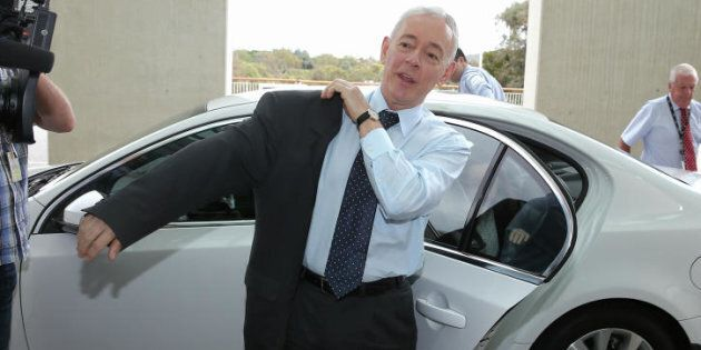 Former Family First Senator Bob Day puts his jacket on... to go