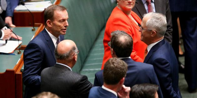 Former Prime Minister Tony Abbott chats with Prime Minister Malcolm