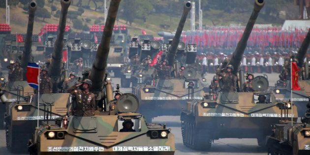 Korean People's howitzers are paraded through Kim Il-Sung square in
