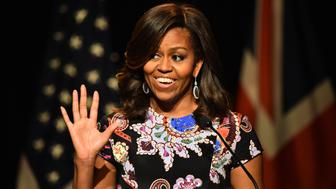 LONDON, ENGLAND - JUNE 16:  US First Lady Michelle Obama gestures with her hand outstretched as she speaks to students as part of the 'Let Girls Learn Initiative' at the Mulberry School for Girls on June 16, 2015 in London, England. The US First Lady is travelling with her daughters, Malia and Sasha and her mother, Mrs. Marian Robinson, to continue a global tour promoting her 'Let Girls Learn Initiative'. The event at the school was to discuss how the UK and USA are working together to expand girl's education around the world.  (Photo by Jeff J Mitchell/Getty Images)