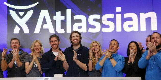 Mike Cannon-Brookes (C), co-founder and CEO of Atlassian Software Systems, and Scott Farquhar (3rd L),...