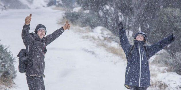 Revellers enjoy the snow