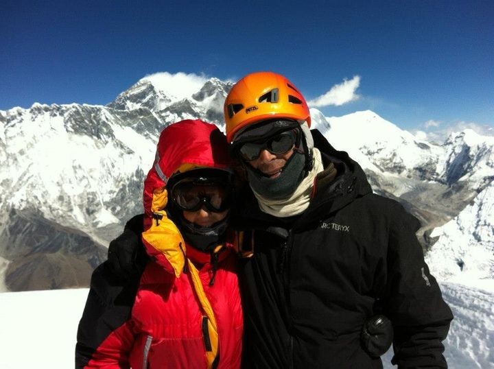 Di Westaway on the summit of Mt Ama Dablam, Nepal, with Everest in background