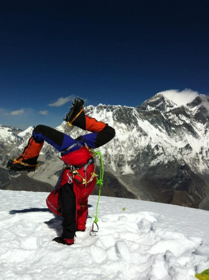 Di Westaway doing the world's highest handstand on the summit of Mt Ama Dablam, Nepal