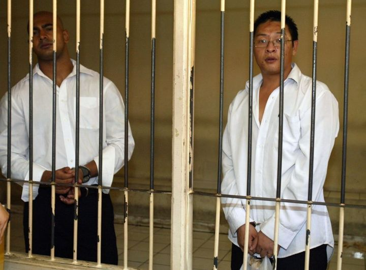 Australians Andrew Chan (R) and Myuran Sukumaran, pictured here inside a holding cell at a Denpasar court in 2006, were executed in April 2015 amid anger in Australia.