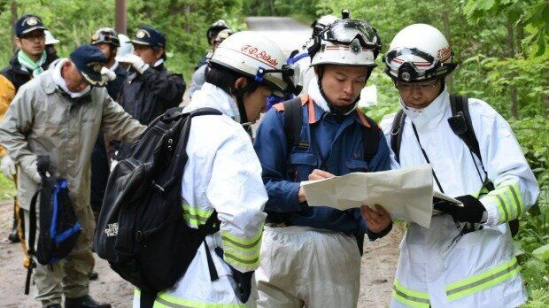 Japanese police rescue workers looking for 7 year old