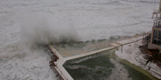 Waves crash into Bondi's Icebergs