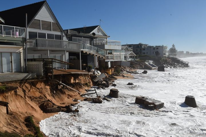 High tide begins to impact on damaged beachfront homes along Pittwater Road at Collaroy.