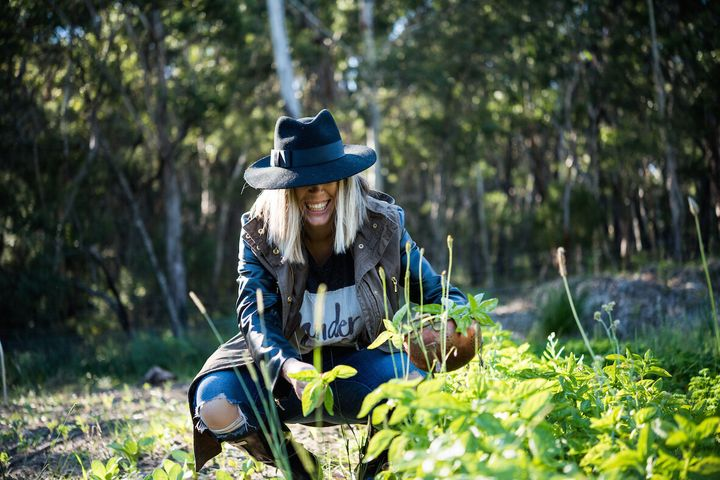Monley tends her farm's organic produce garden at Berrima.