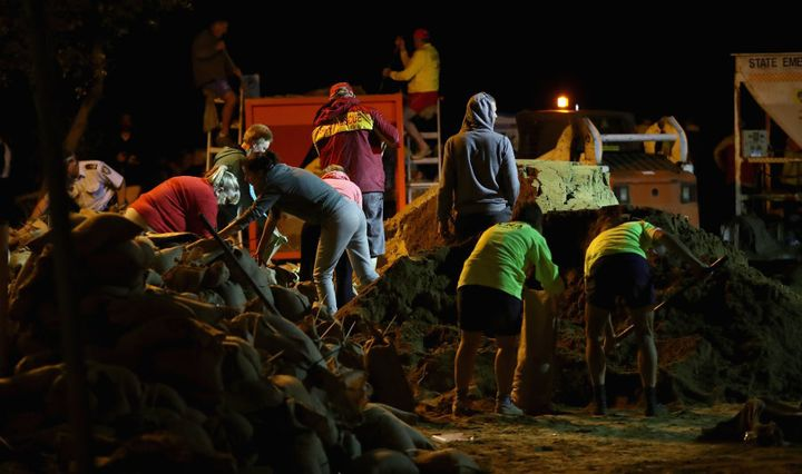 NSW Rural Fire Service workers, NSW State Emergency Service, Surf Lifesavers, Northern Beaches Council workers sandbagged through the night.