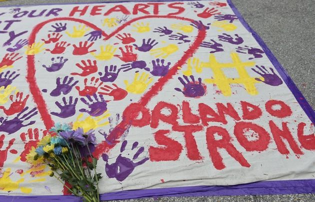 A makeshift memorial with flowers and hand prints near the Pulse nightclub in Orlando,