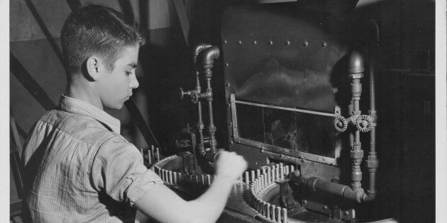 A young boy working in a war factory