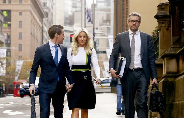 Oliver Curtis and wife Roxy Jacenko arrive at his insider trading trial on June