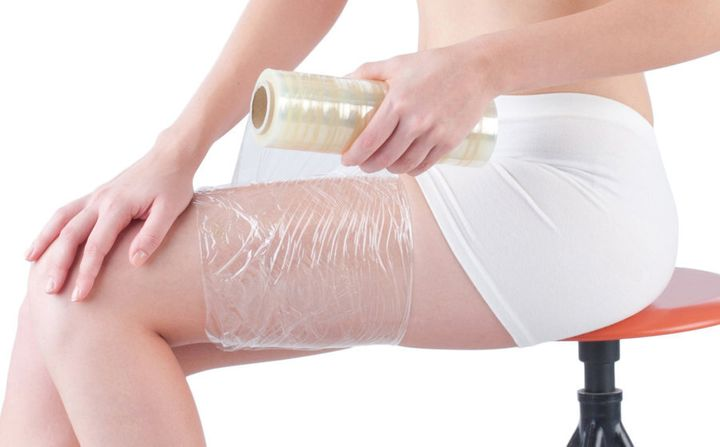 Plastic wrap should be applied to the burn after running it under cold water.