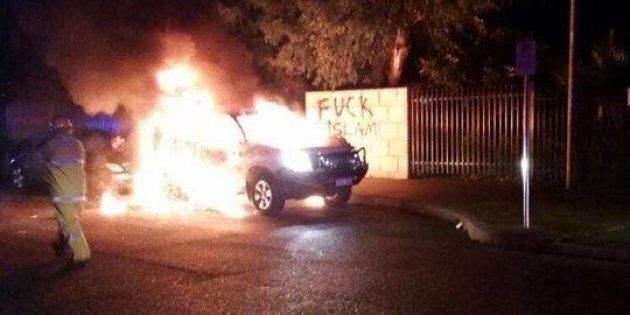 A Toyota Prado burns outside the Thornlie Mosque in WA in what is believed to be a suspected petrol