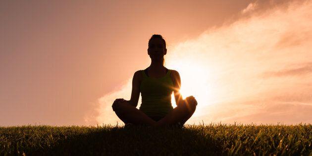 Woman meditating in yoga