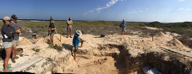 Archaeologists from the Western Australian Museum and The University of Western Australia examining archaeological...
