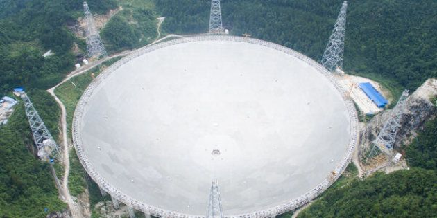 Construction on the Five-hundred-meter Aperture Spherical Telescope, or FAST, began in 2011. Workers installed the last of 4,450 panels on Sunday and operations are scheduled to begin in September.