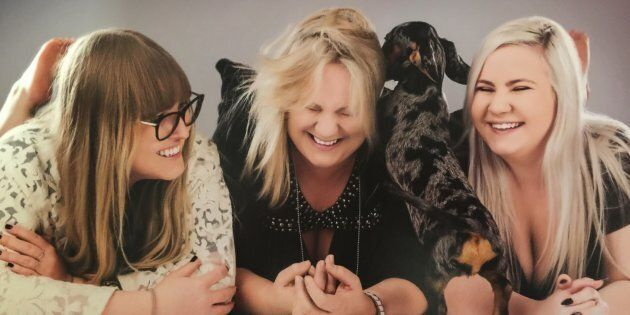 Jessica Cameron, left, with her sister Ebony and mum Joanne who have both supported her choice to leave a lucrative career in law to start her online pet accessories business.