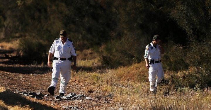 Leeton Volunteer Rescue members search for the body of murdered school teacher Stephanie Scott.