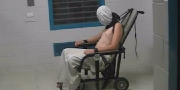 A teenage boy pictured strapped to a chair in the NT Don Dale