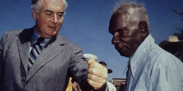 Prime Minister Gough Whitlam pours soil into the hands of traditional landowner Vincent Lingiari, Northern...