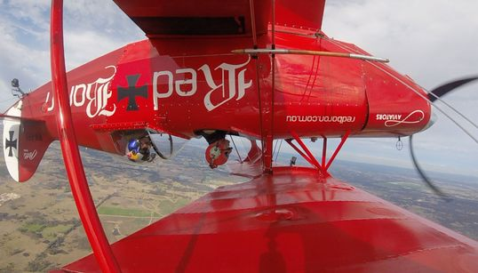 We Interviewed This Pilot Upside Down, Because That's How He's Flying Across