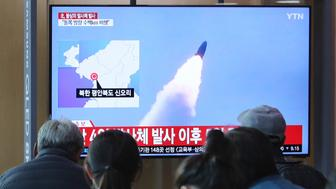 "People watch a TV showing file footage of North Korea's missile launch during a news program at the Seoul Railway Station in Seoul, South Korea, Thursday, May 9, 2019. North Korea on Thursday fired at least one unidentified projectile from the country's western area, South Korea's military said, the second such launch in the last five days and a possible warning that nuclear disarmament talks could be in danger. The signs read: North Korea fired unidentified projectiles"". (AP Photo/Ahn Young-joon)"