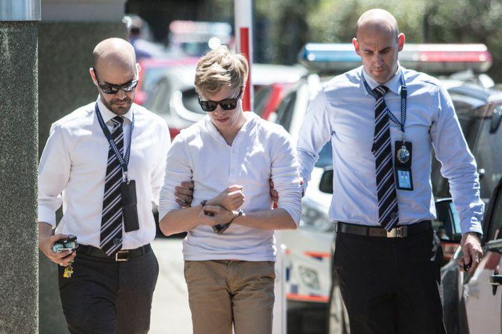 Suspects in the Tiahleigh Palmer murder investigation arrive under arrest at Logan Police Station on September 20, 2016 in Brisbane