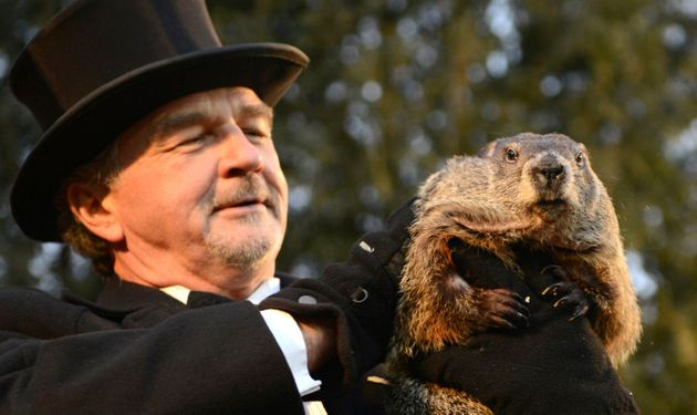 Groundhog co-handler John Griffiths holds up Punxsutawney Phil after his annual weather