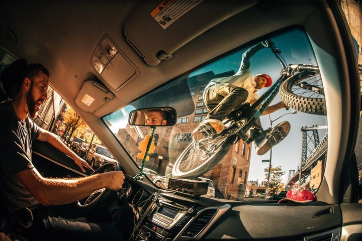 Ale Di Lullo's fun shot of Aaron Chase riding his mountain bike on the windshield of a NYC cab.
