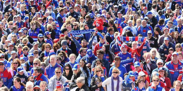 Whitten Oval is full of Western Bulldogs fans celebrating their team's AFL premiership