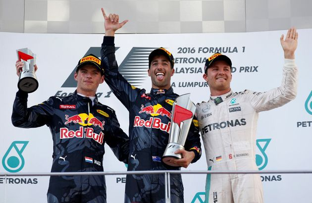 Ricciardo, Max Verstappen and Nico Rosberg celebrate on the podium after the Malaysian Grand