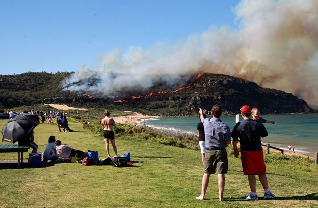 Aussies look on as a fire breaks out in 2013 at Sydney's Palm